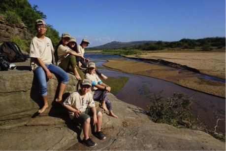 Peter and his fellow Wild Rhino Youth Ambassadors on trail in South Africa in July 2017